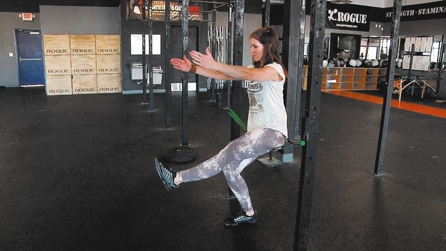 Starting position for pistol squat with Laura Salcedo at Cross Fit Mountain's Edge on Wednesday March 19, 2014. (Michael Quine/Las Vegas Review-Journal)