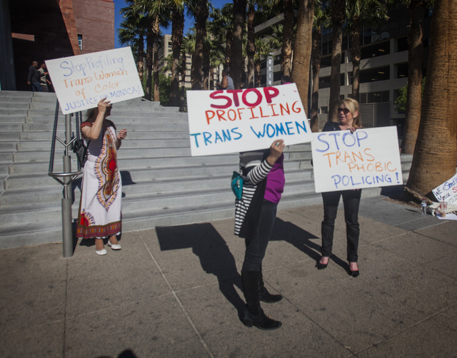 Laura Benson,left, Elizabeth Trujillo and Lisa Mellott  protests in front of Regional Justice Center on Friday, March 14, 2014. About 10 people demonstrated against transgender phobia. (Jeff Schei ...