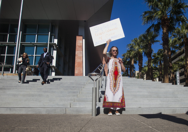 Laura Benson protests in front of Regional Justice Center on Friday, March 14, 2014. About 10 people demonstrated against transgender phobia. (Jeff Scheid/Las Vegas Review-Journal)