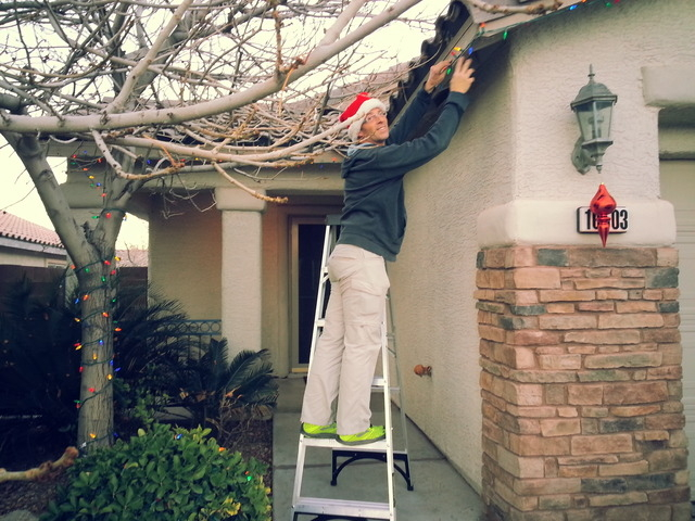 Keith Johnson hangs Christmas lights on his south Summerlin home. (Special to View)