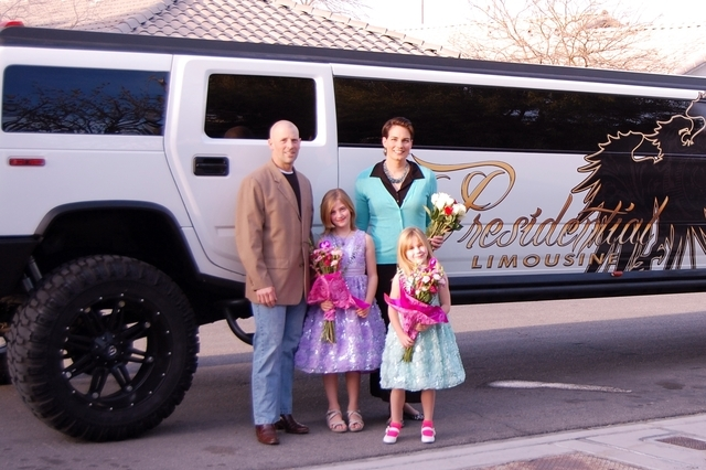 """Keith and Sharon Johnson stand with their daughters Regan, 8, and Zoey, 5, next to the limousine they hired on Feb. 14 to take them to a picnic at Calico Basin and a family """"Princess Ball"""" at thei ..."""