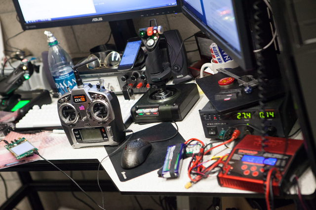 The controls for an unmanned aerial system, otherwise known as a drone, are seen, left, in a lab at the Thomas Beam Engineering Complex on the campus of the University of Nevada, Las Vegas on Mond ...