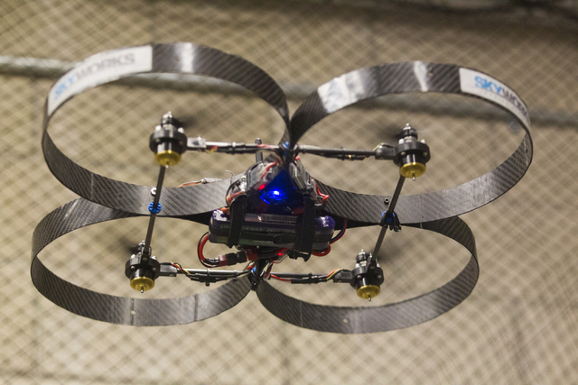 An unmanned aerial system, otherwise known as a drone, is controlled by mechanical engineering senior Greg Friesmuth in a lab at the Thomas Beam Engineering Complex on the campus of the University ...