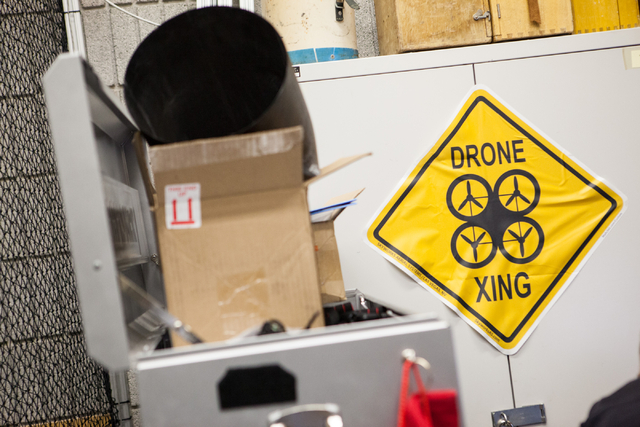 "A ""drone crossing"" sign is seen in the lab where mechanical engineering senior Greg Friesmuth operates an unmanned aerial system, otherwise known as a drone, at the Thomas Beam Engineeri ..."