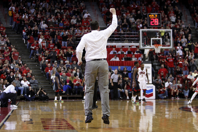 UNLV head coach Dave Rice motions to his players after they took the lead with less than a minute left in overtime during a game against Fresno State at the Thomas & Mack Center in Las Vegas Satur ...