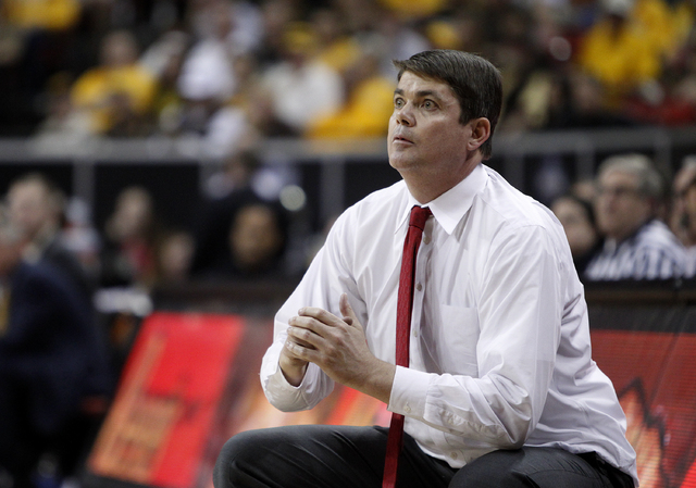 UNLV head coach Dave Rice watches as his team scores against Wyoming in the Mountain West tournament quarterfinals at the Thomas & Mack Center in Las Vegas Thursday, March 13, 2014. (John Locher/L ...