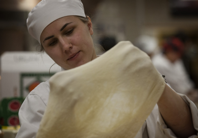 UNLV culinary student Agata Siwinska stretches pizza dough in preparation of the UNLVino recipe tasting on Thursday. The students will prepare 25 dishes to be served at the 40th annual UNLVino on  ...