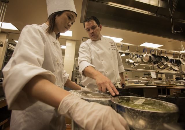 UNLV Culinary Director Mark Sandoval instructs student Mai Guakong during the UNLVino recipe tasting on Thursday. The students will prepare 25 dishes to be served at the 40th annual UNLVino on Apr ...