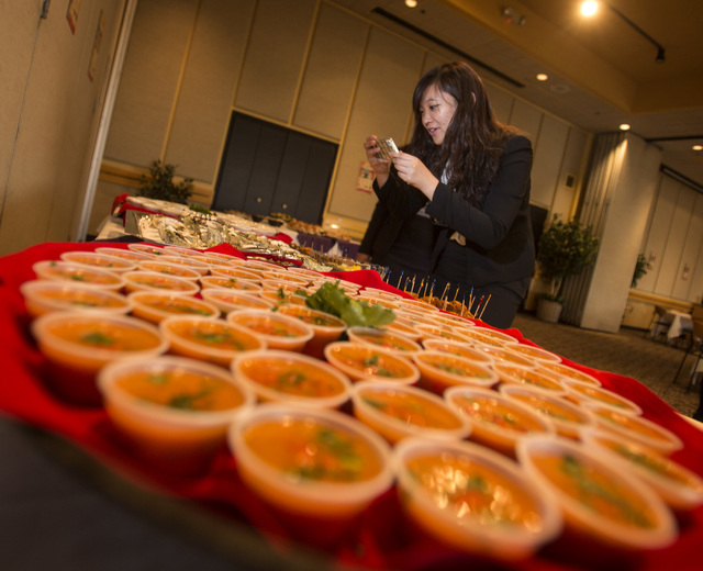 UNLV student Veronica Hsiao take photos during the UNLVino recipe tasting at UNLV College of Hotel Administration on Thursday. The students will prepare 25 dishes to be served at the 40th annual U ...