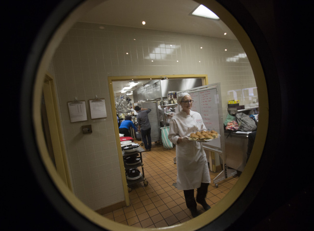 UNLV culinary student Nicole Cook carries tray of sandwiches during the UNLVino recipe tasting on Thursday. The students will prepare 25 dishes to be served at the 40th annual UNLVino on April 12. ...