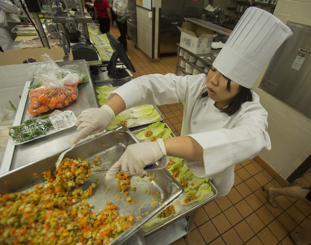 UNLV culinary student  Kedang Pan prepares lettuce cups with fried tofu during the UNLVino recipe tasting on Thursday. The students will prepare 25 dishes to be served at the 40th annual UNLVino o ...