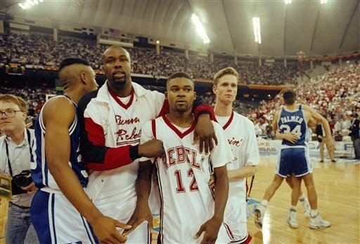 UNLV's Anderson Hunt and UNLV teammates leave the floor after losing to Duke in the NCAA national semi-final game in Indianapolis, March 30, 1991.  Duke defeated UNLV by a score of 79-77.  (AP Pho ...