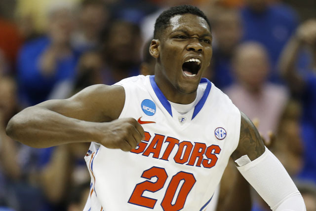 Florida guard Michael Frazier II celebrates a field goal against UCLA during the second half in a regional semifinal game at the NCAA college basketball tournament Thursday in Memphis, Tenn. Flori ...
