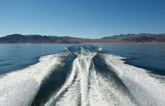 The view from the stern of a speedboat racing across Lake Mead on a sunny Sunday, Oct. 20, 2013. California will soon start drawing down the water it has banked in Lake Mead - removing 100,000 to  ...