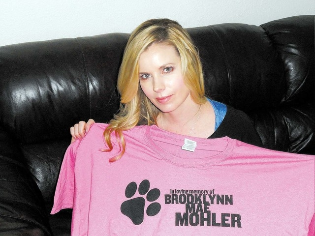 Darchel Mohler holds a T-shirt for the Brooklynn Mae Mohler Foundation's gun safety awareness event, set for 10 a.m. March 29 at Sunset Park, 2602 E. Sunset Road, area F. The event will feature  ...