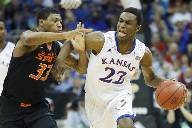 Kansas guard Andrew Wiggins (22) is covered by Oklahoma State guard Marcus Smart (33) during the second half in the quarterfinals of the Big 12 Conference men's tournament in Kansas City, Mo., Thu ...