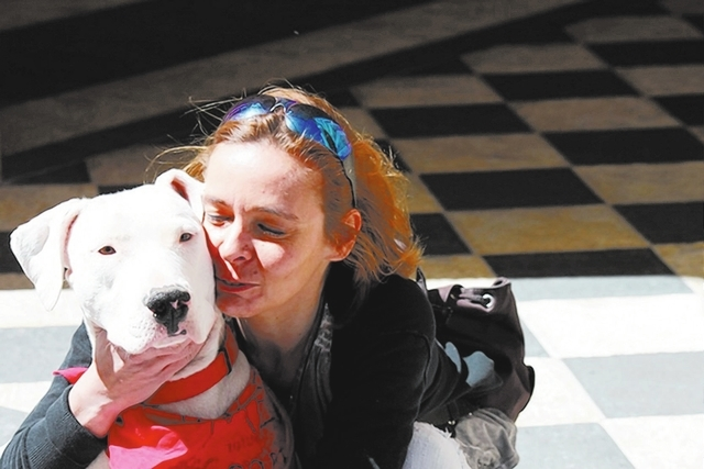 Marion de Fiori, a volunteer with A Home 4 Spot, kisses the dog she is fostering on May 2012 in Las Vegas. (Special to View)