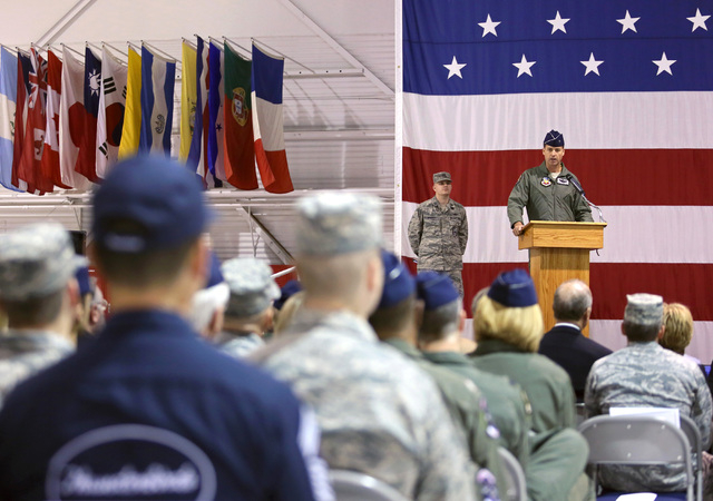Brig. Gen. Charles Moore, Jr., right, speaks during a Change of Command Ceremony at Nellis Air Force Base Friday, Feb. 28, 2014, in Las Vegas. Brig. Gen. Charles Moore, Jr. relinquished command of ...