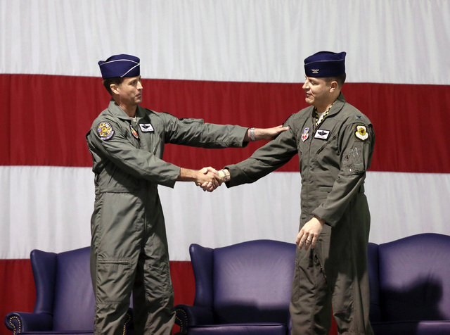 Brig. Gen. Charles Moore, Jr., left, shakes hands with Col. Christopher Short during a Change of Command Ceremony at Nellis Air Force Base Friday, Feb. 28, 2014, in Las Vegas. Brig. Gen. Charles M ...