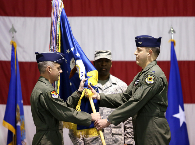 Brig. Gen. Jay Silveria, left, and Col. Christopher Short participate in a Change of Command ceremony at Nellis Air Force Base on Friday. (Ronda Churchill/Las Vegas Review-Journal)