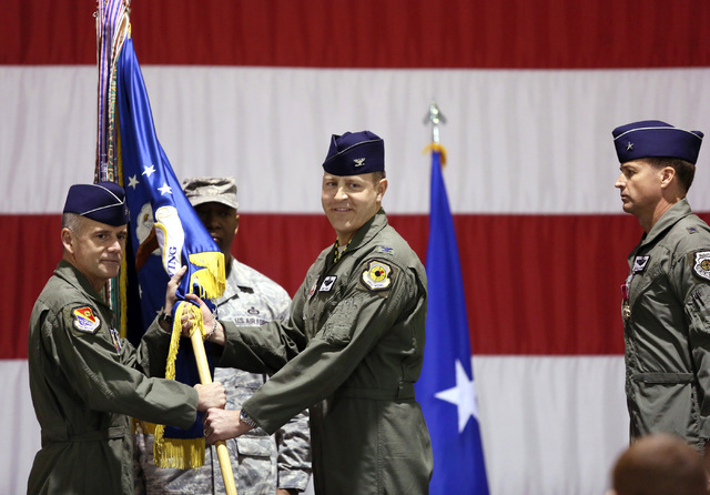 Brig. Gen. Jay Silveria, left, and Col. Christopher Short, center, participate in a Change of Command Ceremony at Nellis Air Force Base Friday, Feb. 28, 2014, in Las Vegas. Brig. Gen. Charles Moor ...