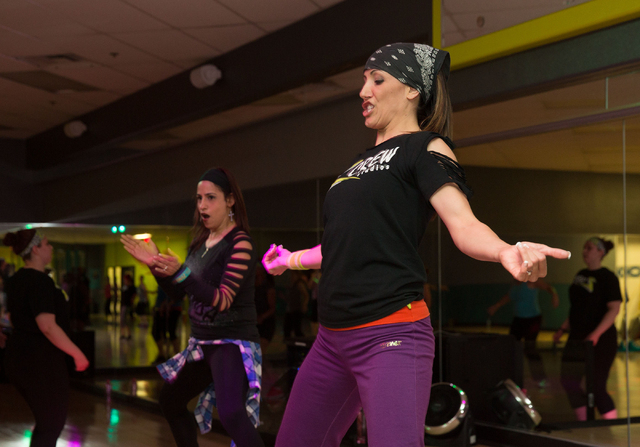 Zumba instructors Miche Wilk, left, and Michelle Velez, right, lead a class at Z Crew Studios, Feb. 26. (Samantha Clemens/View)