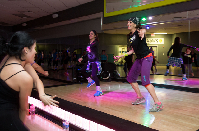 Zumba instructors Miche Wilk, left on stage, and Michelle Velez, right, lead a class at Z Crew Studios, 3165 N. Rainbow Blvd., Feb. 26. The facility, which opened in January, hosted a fundraiser M ...