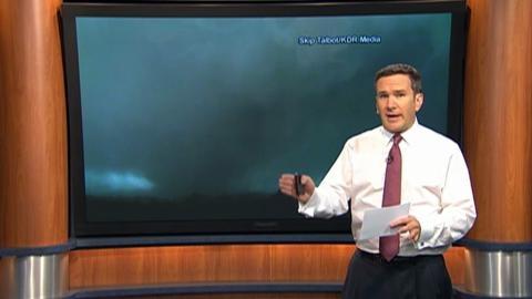 TV meteorologist orders staff to flee tornado during live