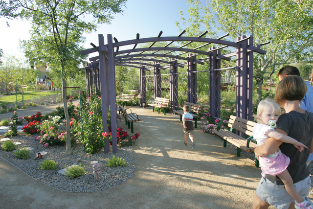 A family walks in the gardens at the Springs Preserve, 333 S. Valley View Blvd., where activities, shows and tours are planned through April for families and children during spring break. (Special ...