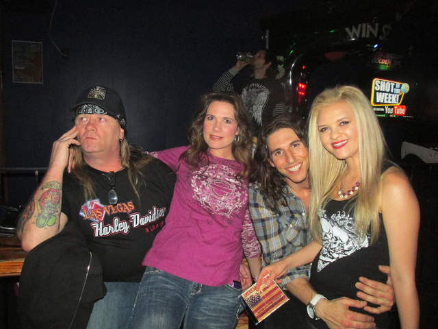 Miranda Hardy, right, from the band Forever My Secret poses for the camera with her friends during the Liberation Through Music & Art event held at The Cheyenne Saloon, 3103 N. Rancho Drive in Las ...