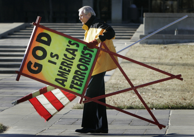 The Rev. Fred Phelps Sr. prepares to protest outside the Kansas Statehouse on July 1, 2007, in Topeka, Kan. Phelps, the founder of the Kansas church known for anti-gay protests and pickets at mili ...