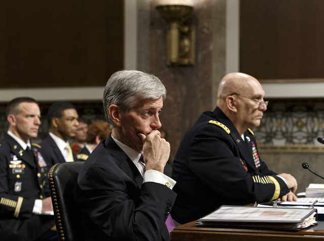 Army Secretary John M. McHugh, left, and Army Chief of Staff Gen Raymond Odierno update members of the Senate Armed Services Committee on Thursday about the deadly shooting rampage by a soldier We ...