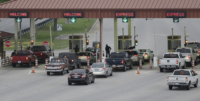 Security check vehicles as they enter Fort Hood's main gate on Thursday in Fort Hood, Texas. A soldier opened fire Wednesday on fellow service members at the military base, killing three people an ...