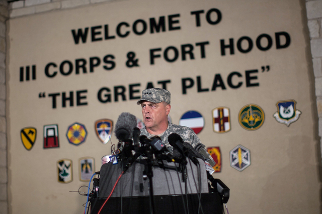 Lt. Gen. Mark Milley, commanding general of III Corps and Fort Hood, speaks with the media outside of an entrance to the Fort Hood military base after a shooting that occurred inside on Wednesday  ...