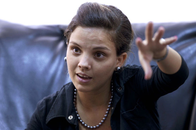 In this Feb. 28, 2014 photo, Saimi Reyes speaks during an interview with Associated Press in Havana, Cuba. The Obama administration secretly financed a social network in Cuba to stir political unr ...