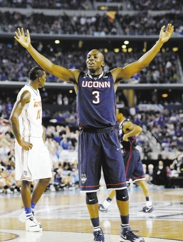 Connecticut guard Terrence Samuel celebrates against Florida during the second half of the NCAA Final Four tournament college basketball semifinal game Saturday, April 5, 2014, in Arlington, Texas ...