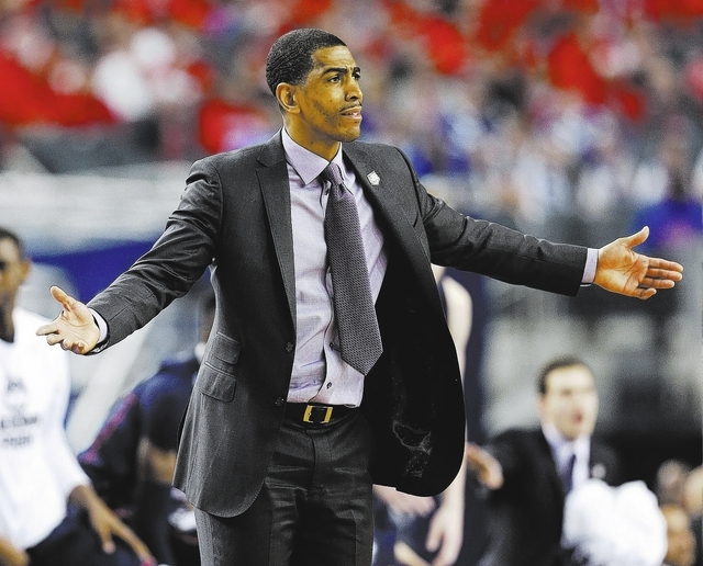 Connecticut head coach Kevin Ollie reacts during the first half of the NCAA Final Four tournament college basketball semifinal game against Florida Saturday, April 5, 2014, in Arlington, Texas. (A ...