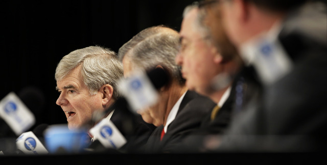 NCAA President Mark Emmert answers a question at a news conference Sunday, April 6, 2014, in Arlington, Texas. (AP Photo/Tony Gutierrez)