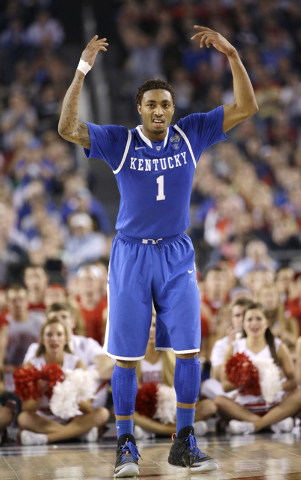 Kentucky guard James Young celebrates during the second half of an NCAA Final Four tournament college basketball semifinal game against Wisconsin Saturday in Arlington, Texas. (AP Photo/David J. P ...