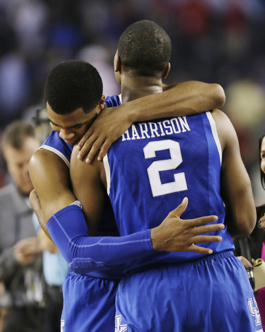 After Kentucky guard Aaron Harrison made a three-point basket in the final seconds against Wisconsin to win the game 74-73, he is embraced his twin brother, guard Andrew Harrison, after their NCAA ...