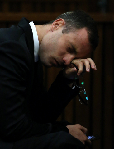 Oscar Pistorius gestures as he listens to evidence by a pathologist in court in Pretoria, South Africa, Monday, April 7, 2014. Pistorius is charged with murder  for the shooting death of his girlf ...