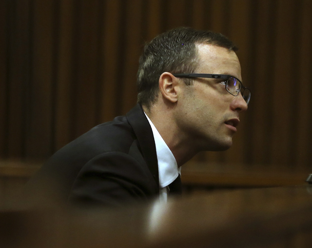 Oscar Pistorius sits in the dock at a court in Pretoria, South Africa, Monday, April 7, 2014. The defense in the Pistorius murder trial has opened its case, calling a pathologist as its first witn ...