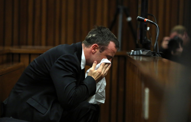 Oscar Pistorius weeps as he listens to evidence by a pathologist in court in Pretoria, South Africa, Monday, April 7, 2014. Pistorius is charged with murder  for the shooting death of his girlfrie ...