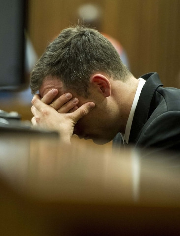 Oscar Pistorius reacts as he listens to evidence by a pathologist in court in Pretoria, South Africa, Monday, April 7, 2014. A pathologist called as the first defense witness in the Oscar Pistoriu ...