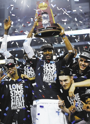 Connecticut forward DeAndre Daniels holds up the championship trophy after the Huskies beat the Kentucky Wildcats 60-54 at AT&T Stadium in Arlington, Texas, on Monday night. The Huskies, led by gu ...