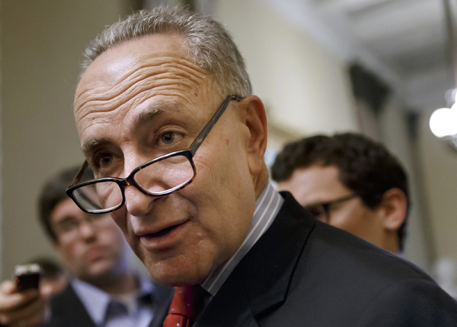 Sen. Charles Schumer, D-N.Y. speaks on March 26 on Capitol Hill in Washington. Capping a three-month struggle, the Senate closed in Monday on passage of election-year legislation to restore jobles ...