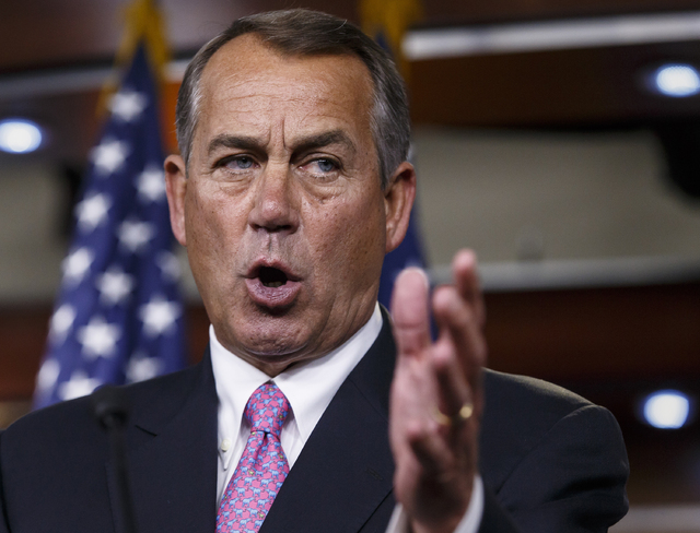 House Speaker John Boehner of Ohio speaks on March 26 during a news conference on Capitol Hill in Washington. Capping a three-month struggle, the Senate closed in Monday on passage of election-yea ...
