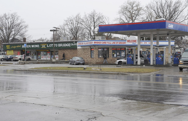 Cars enter local businesses at the scene of an attack on Thursday, April 3, 2014 in Detroit. A suburban Detroit man was in critical condition Thursday with severe head injuries after a neighborhoo ...
