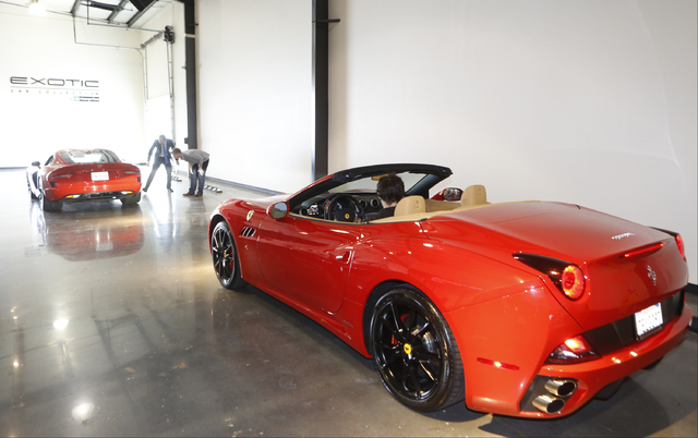Douglas Sawyer, 23, top right, rents out a 2013 Dodge Viper, left, while his friend, Michael Clark, 22, sits inside a 2014 Ferrari California at the Enterprise Exotic Car Collection showroom near  ...