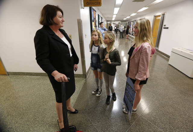 Ava Kotler, 12, right, her sister Kirra, 10, second from right,  and Lizzie Gordon, 11, talk with Assembly Speaker-elect Toni Atkins, D-San Diego, urging her support for a bill to ban the holding  ...